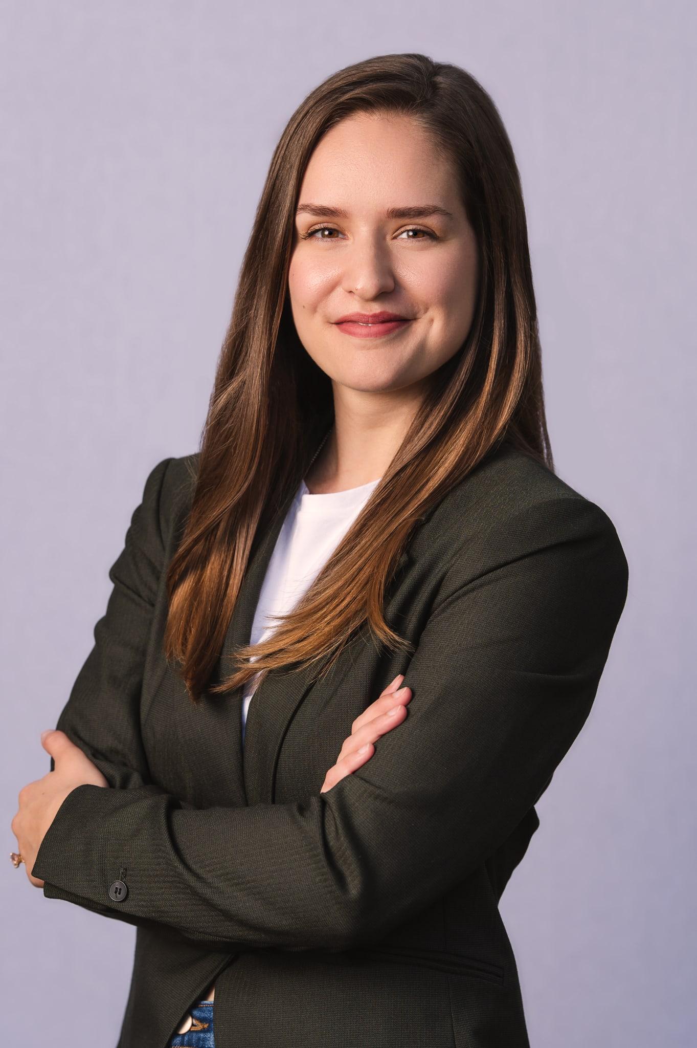 Headshot of young, female professional.